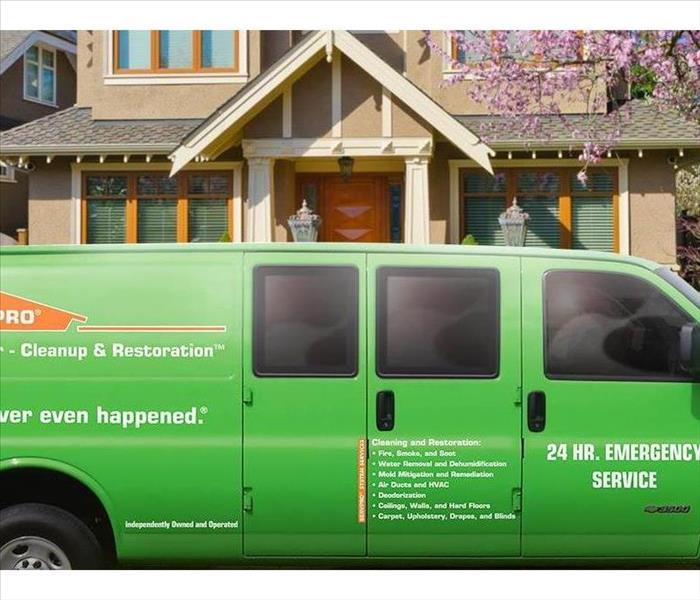 SERVPRO van with fire and water, restoration and cleanup  logo